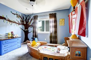 Cheerful kids room in light purple color with boat bed and murals