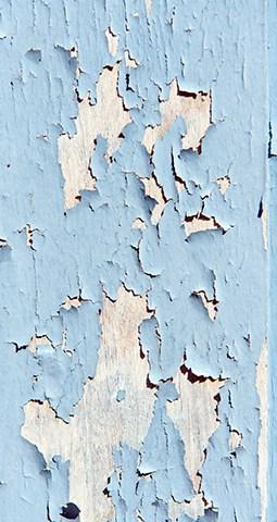 Pale blue peeling paint on whitened woodPale blue peeling paint on whitened wood